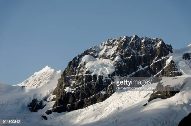 scenic view of snowcapped mountains against clear blue sky - gerhard schimpf stock pictures, royalty-free photos & images