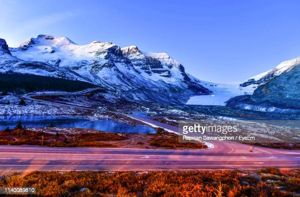 scenic view of snowcapped mountains against clear sky - columbia icefield stock pictures, royalty-free photos & images