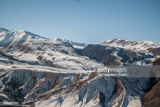 scenic view of snowcapped mountains against clear sky - bishkek stock pictures, royalty-free photos & images