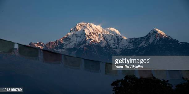 scenic view of snowcapped mountains against clear sky - annapurna south stock pictures, royalty-free photos & images