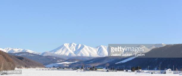 scenic view of snowcapped mountains against clear sky - hokkaido stock pictures, royalty-free photos & images