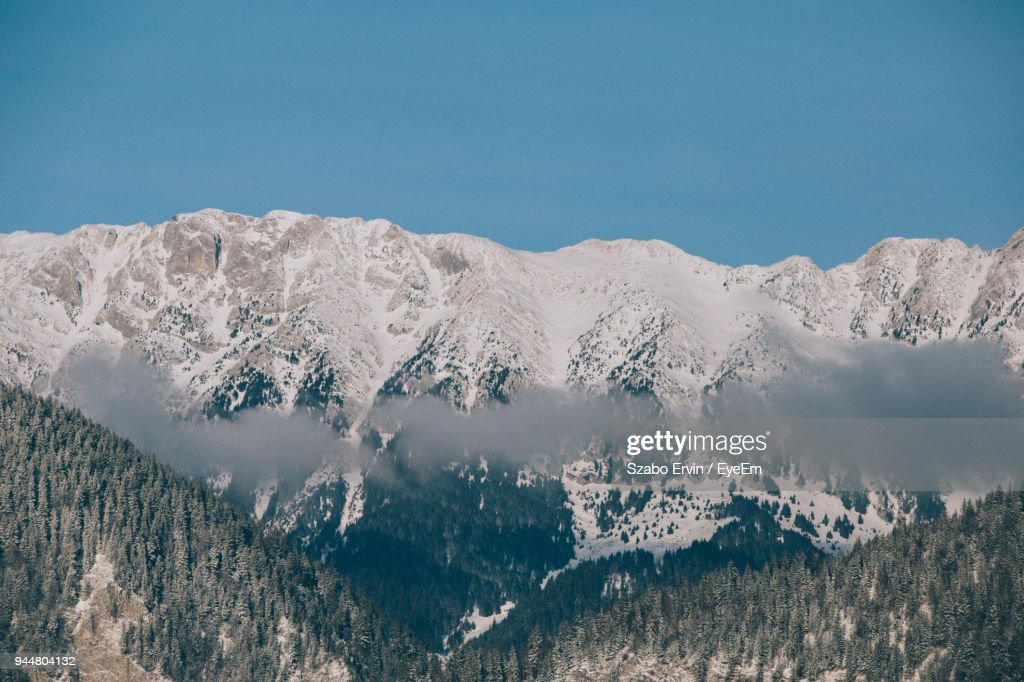 Scenic View Of Snowcapped Mountains Against Clear Sky : Stock Photo