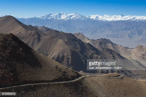 scenic view of snowcapped mountains against clear sky - indore stock photos and pictures
