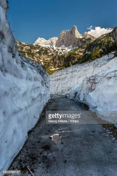 scenic view of snowcapped mountains against clear sky,gosau,austria - weg bildbanksfoton och bilder