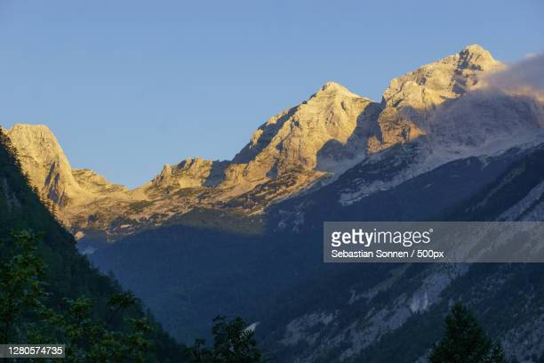 scenic view of snowcapped mountains against clear sky,tolmin,slovenia - baum stock pictures, royalty-free photos & images