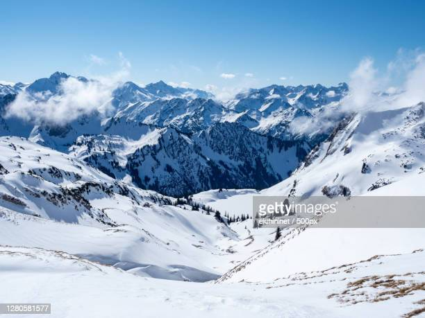 scenic view of snowcapped mountains against sky,nebelhorn,oberstdorf,germany - oberstdorf stock pictures, royalty-free photos & images