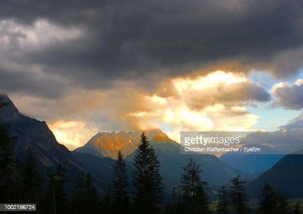 Scenic View Of Snowcapped Mountains Against Sky At Dusk