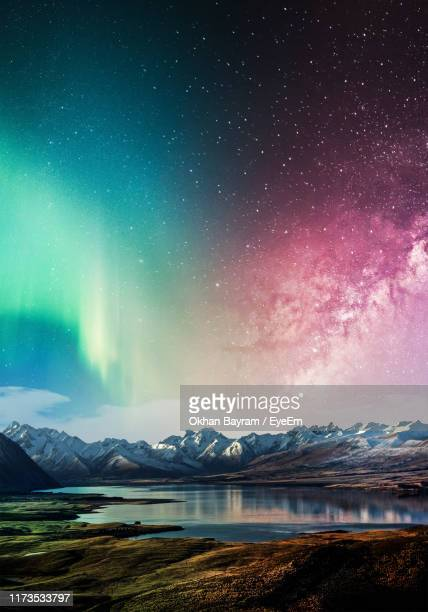 scenic view of snowcapped mountains against sky at night - aurora borealis stock pictures, royalty-free photos & images