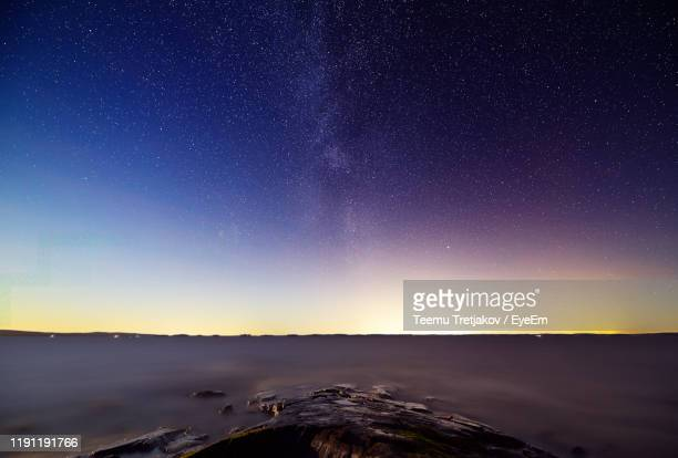 scenic view of snowcapped mountains against sky at night - teemu tretjakov stock pictures, royalty-free photos & images