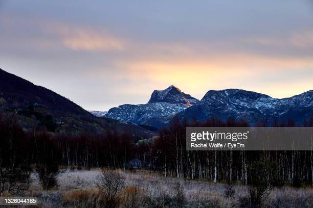 scenic view of snowcapped mountains against sky at sunset - rachel wolfe stock pictures, royalty-free photos & images