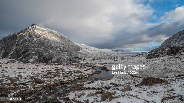 scenic view of snowcapped mountains against sky, bethesda, united kingdom - season stock pictures, royalty-free photos & images