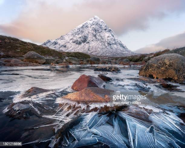 scenic view of snowcapped mountains against sky during winter,glencoe,ballachulish,scotland,united kingdom,uk - winter stock pictures, royalty-free photos & images