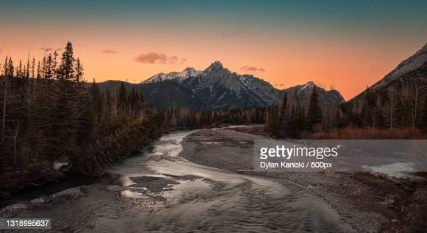 scenic view of snowcapped mountains against sky during sunset,kananaskis,canada - extreme terrain stock pictures, royalty-free photos & images