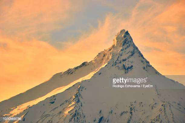 scenic view of snowcapped mountains against sky during sunset - petrohue river stock photos and pictures