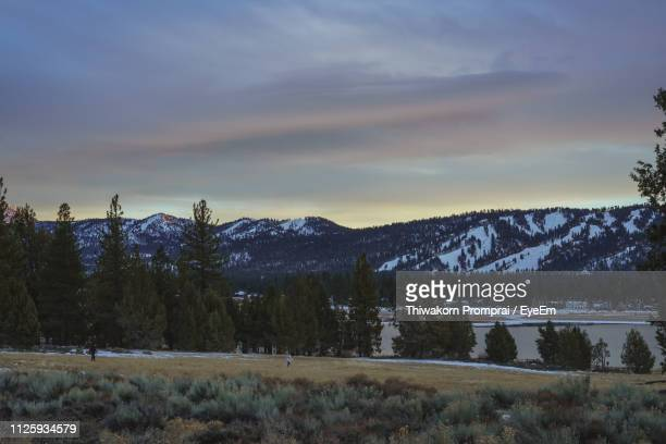 scenic view of snowcapped mountains against sky during sunset - big bear lake stock pictures, royalty-free photos & images
