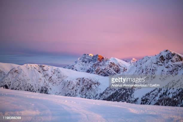 scenic view of snowcapped mountains against sky during sunset - european alps stock pictures, royalty-free photos & images