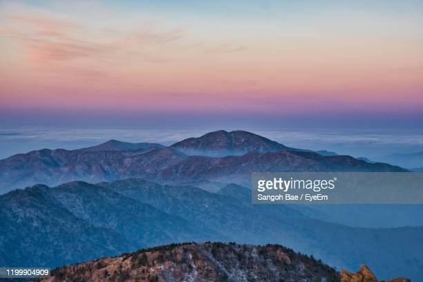 scenic view of snowcapped mountains against sky during sunset - gwangju stock pictures, royalty-free photos & images