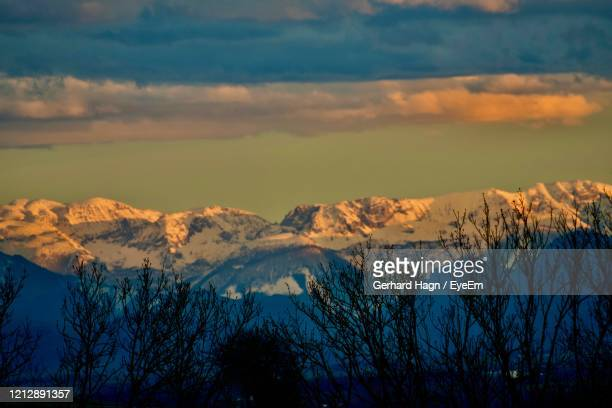 scenic view of snowcapped mountains against sky during sunset - gerhard hagn stock-fotos und bilder