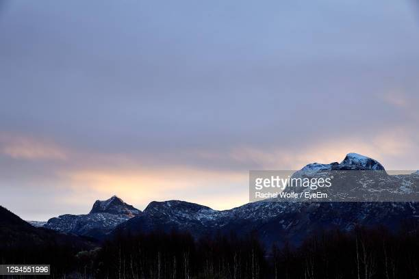 scenic view of snowcapped mountains against sky during sunset - rachel wolfe stock pictures, royalty-free photos & images