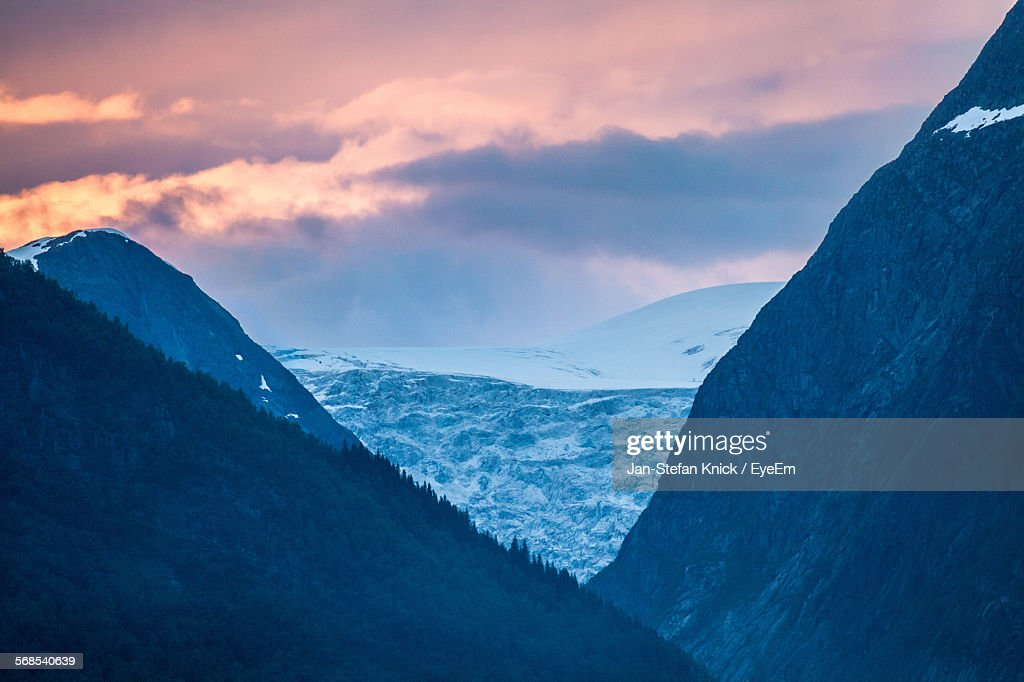Scenic View Of Snowcapped Mountains Against Sky During Sunset : Stock Photo