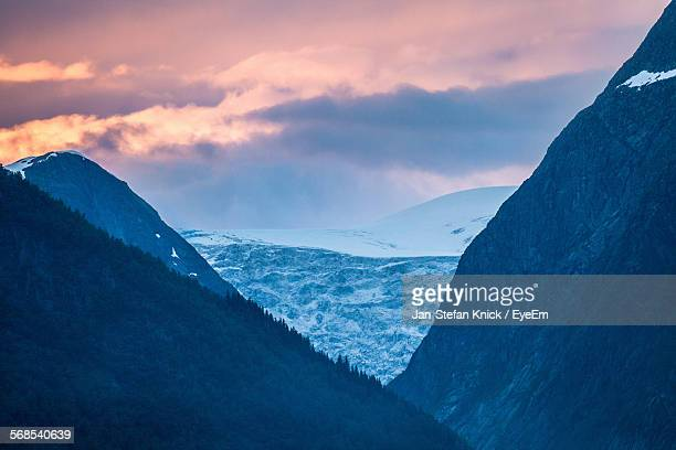 scenic view of snowcapped mountains against sky during sunset - crevasse stock photos and pictures