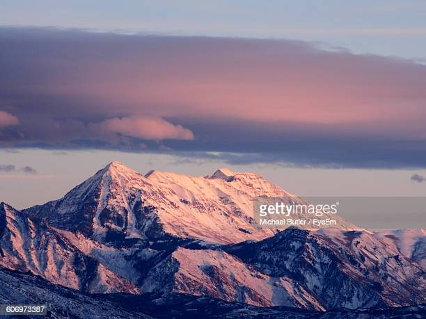 scenic view of snowcapped mountains against sky during sunset - salt lake city utah stock photos and pictures