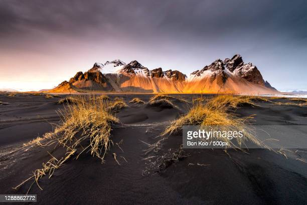 scenic view of snowcapped mountains against sky during sunset,iceland - iceland stock pictures, royalty-free photos & images