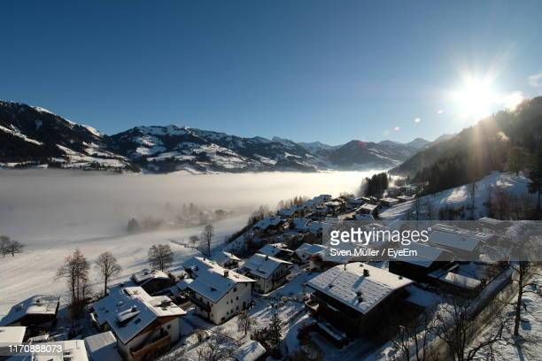 scenic view of snowcapped mountains against sky during winter - kitzbühel stock pictures, royalty-free photos & images