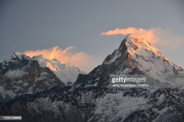 scenic view of snowcapped mountains against sky during winter - annapurna south stock pictures, royalty-free photos & images