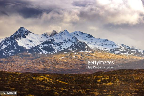 scenic view of snowcapped mountains against sky - mountain range stock pictures, royalty-free photos & images