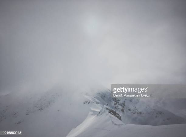 scenic view of snowcapped mountains against sky - sallanches stock pictures, royalty-free photos & images
