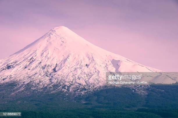 scenic view of snowcapped mountains against sky - petrohue river stock photos and pictures