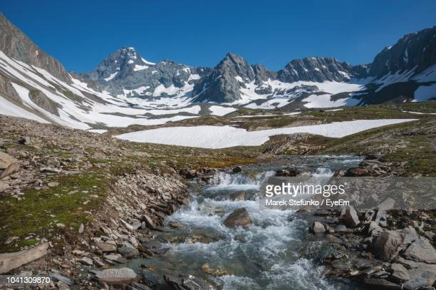 scenic view of snowcapped mountains against sky - marek stefunko imagens e fotografias de stock