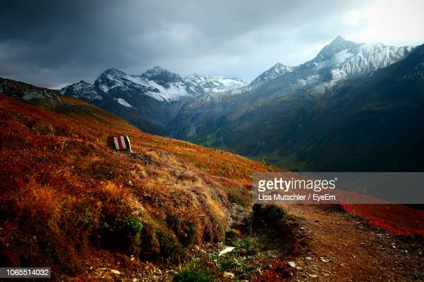 scenic view of snowcapped mountains against sky - davos stock pictures, royalty-free photos & images