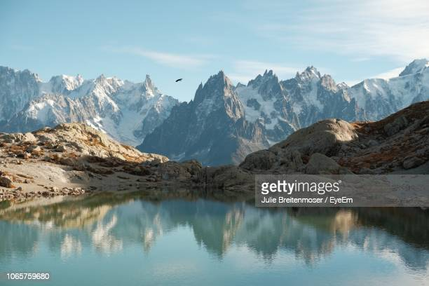 scenic view of snowcapped mountains against sky - mont blanc massif stock photos and pictures