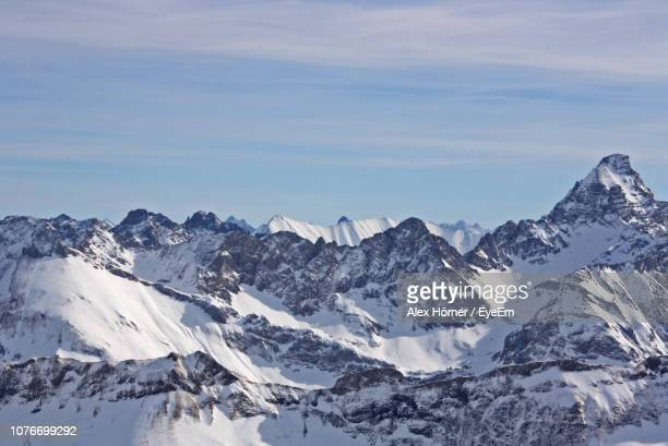 scenic view of snowcapped mountains against sky - oberstdorf stock pictures, royalty-free photos & images