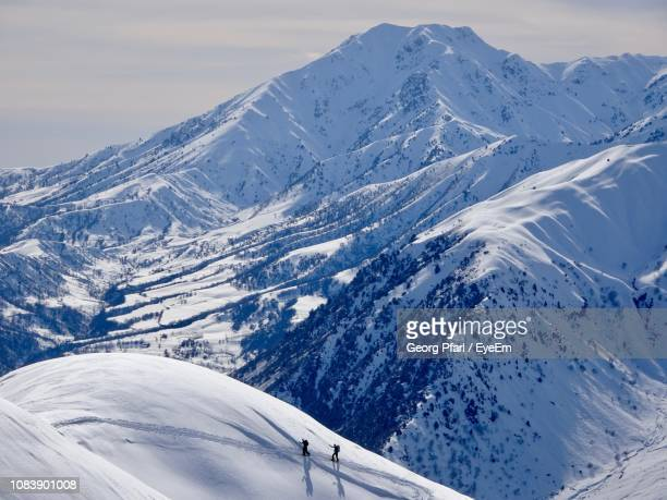 scenic view of snowcapped mountains against sky - kyrgyzstan stock pictures, royalty-free photos & images