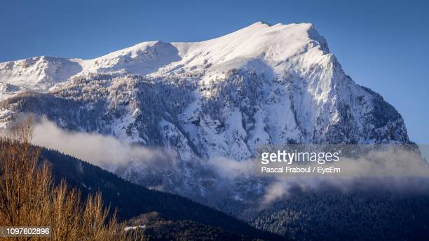 scenic view of snowcapped mountains against sky - embrun stock pictures, royalty-free photos & images