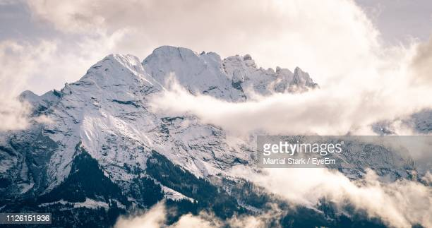 scenic view of snowcapped mountains against sky - martial stock pictures, royalty-free photos & images