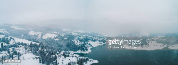 scenic view of snowcapped mountains against sky - bortes stock pictures, royalty-free photos & images