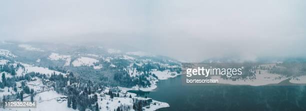 scenic view of snowcapped mountains against sky - bortes foto e immagini stock