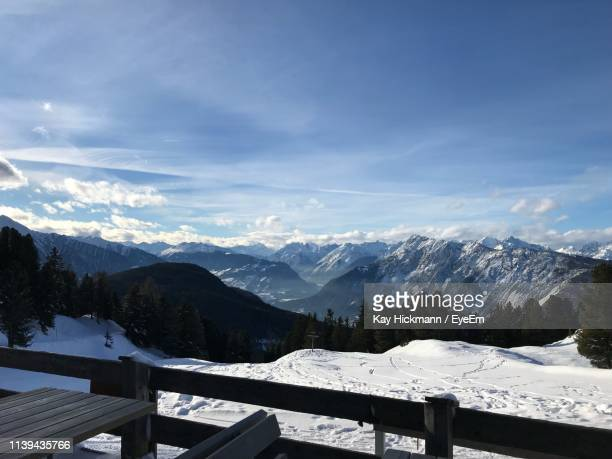 scenic view of snowcapped mountains against sky - wald stock pictures, royalty-free photos & images