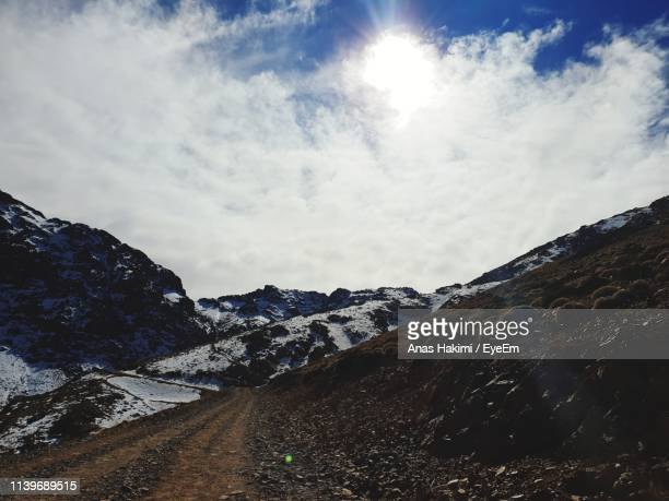 scenic view of snowcapped mountains against sky - hakimi stock photos and pictures