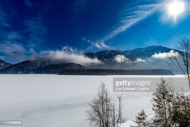 scenic view of snowcapped mountains against sky - lenggries stock pictures, royalty-free photos & images