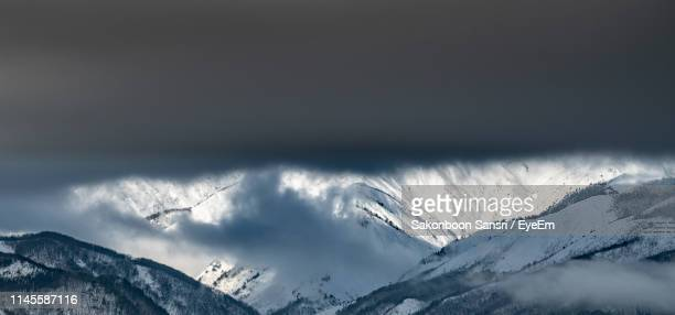 scenic view of snowcapped mountains against sky - land feature stock pictures, royalty-free photos & images
