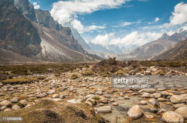 scenic view of snowcapped mountains against sky - nepal stock pictures, royalty-free photos & images