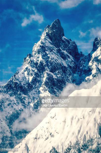 scenic view of snowcapped mountains against sky - monte bianco foto e immagini stock