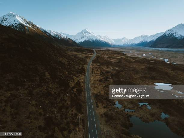 scenic view of snowcapped mountains against sky - canterbury region new zealand stock pictures, royalty-free photos & images