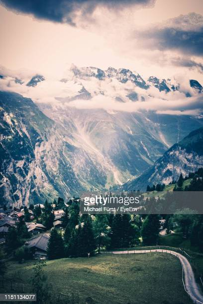 scenic view of snowcapped mountains against sky - lauterbrunnen stock pictures, royalty-free photos & images