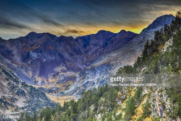 scenic view of snowcapped mountains against sky - タルブ ストックフォトと画像